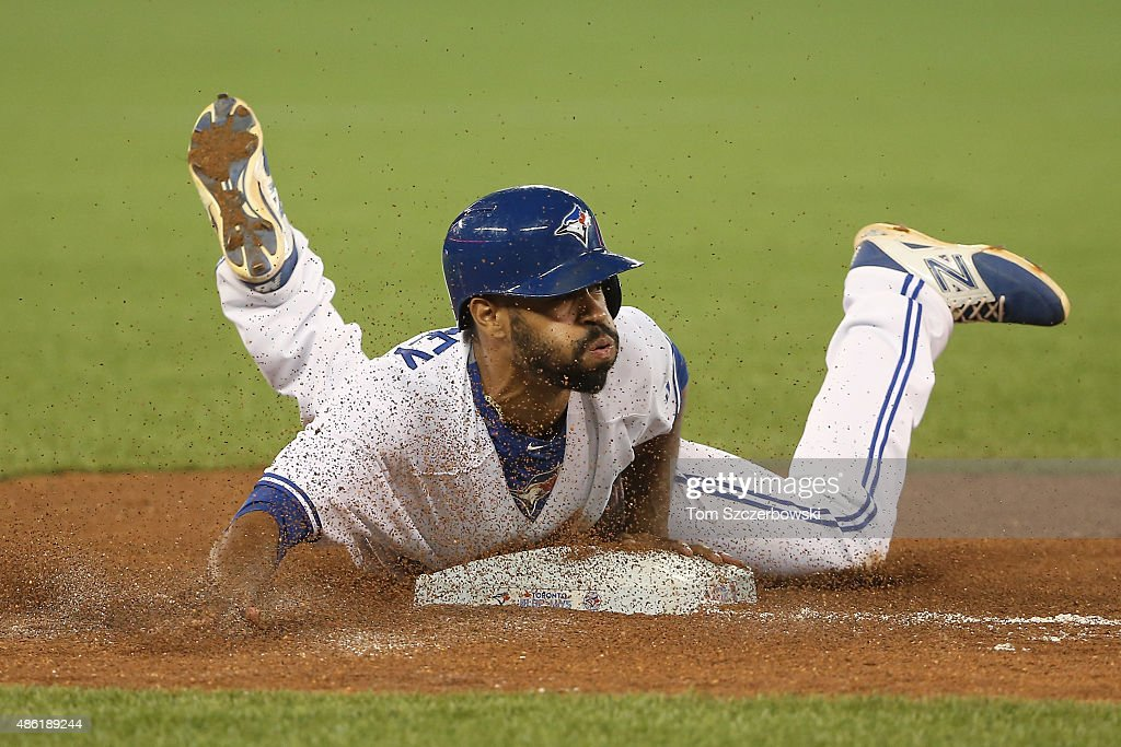 Dalton Pompey #45 of the Toronto Blue Jays steals third base in the seventh inning during MLB game action against the Cleveland Indians on September 1, 2015 at Rogers Centre in Toronto, Ontario, Canada.