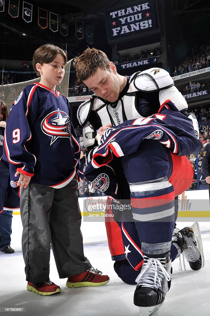 Dalton Prout #47 of the Columbus Blue Jackets signs his game-worn jersey for a fan after a game against the Nashville Predators on April 27, 2013 at Nationwide Arena in Columbus, Ohio. Columbus defeated Nashville 3-1.