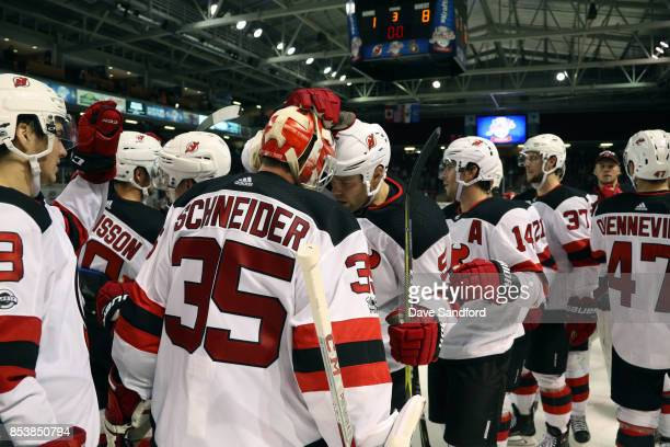 Dalton Prout of the New Jersey Devils celebrates his teams win over the Ottawa Senators with teammate Cory Schneider of the New Jersey Devilsduring...