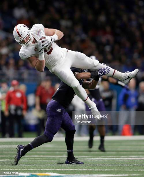 Dalton Schultz of the Stanford Cardinal catches a pass and is tackled by Niko Small of the TCU Horned Frogs in the second quarter during the Valero...