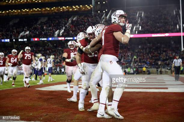 Dalton Schultz of the Stanford Cardinal gestures for the Washington Huskies fans to be quiet after Bryce Love of the Stanford Cardinal scored a...