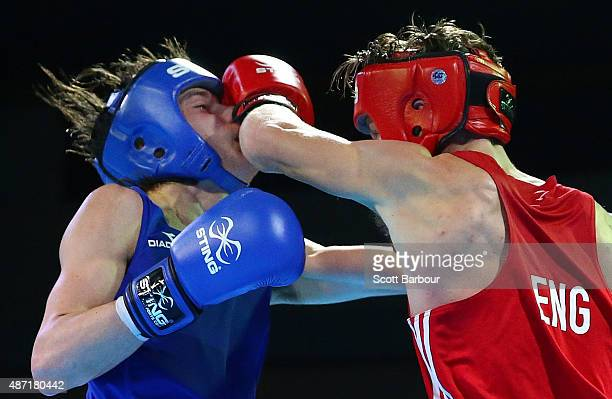 Dalton Smith of England punches Harrison Garside of Australia during the Youth's Light 60kg Boxing at the Tuanaimato Sports Facility on day one of...