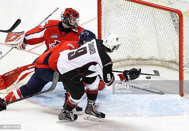 Dalton Sward of the Vancouver Giants scores against goaltender Jarrod Schamerhorn of the Lethbridge Hurricanes during the third period of a WHL game...