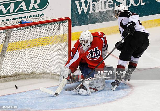 Dalton Sward of the Vancouver Giants scores against goaltender Jonny Hogue of the Lethbridge Hurricanes during the second period of aWHL game at the...