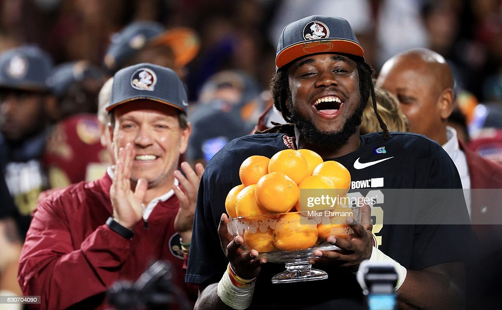 Dalvin Cook #4 and head coach Jimbo Fisher of the Florida State Seminoles celebrate their 33 to 32 win over the Michigan Wolverines during the Capitol One Orange Bowl at Sun Life Stadium on December 30, 2016 in Miami Gardens, Florida.