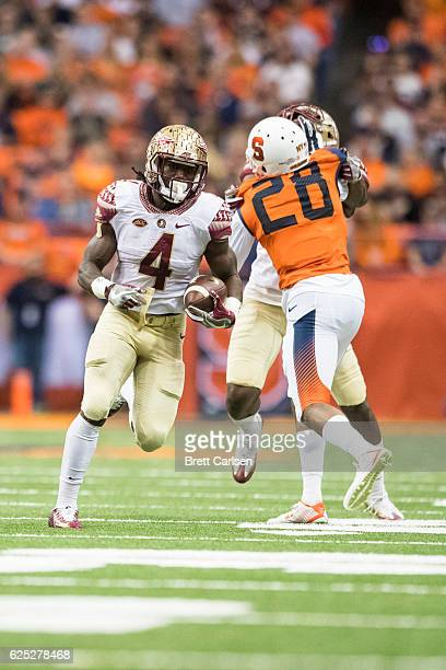 Dalvin Cook of the Florida State Seminoles carries the ball during the first half against the Syracuse Orange on November 19 2016 at The Carrier Dome...