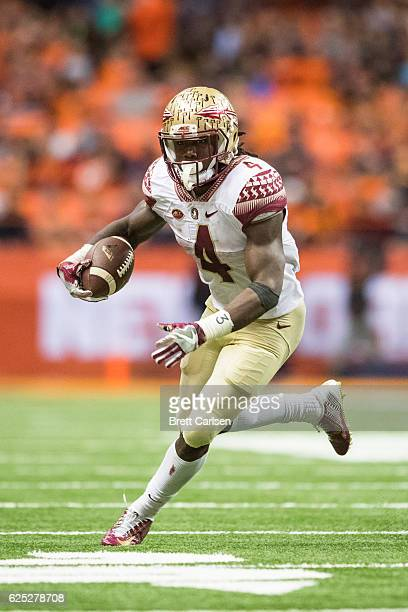Dalvin Cook of the Florida State Seminoles carries the ball during the game against the Syracuse Orange on November 19 2016 at The Carrier Dome in...