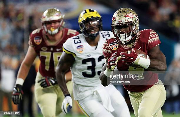 Dalvin Cook of the Florida State Seminoles carries the ball in the first quarter against the Michigan Wolverines during the Capitol One Orange Bowl...