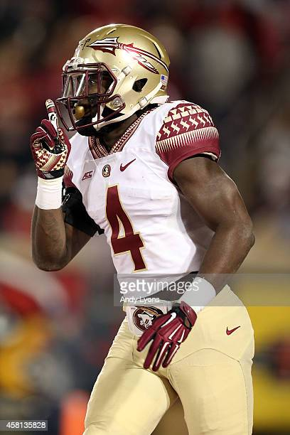 Dalvin Cook of the Florida State Seminoles celebrates after running a 40 yard touchdown in the third quarter against the Louisville Cardinals during...