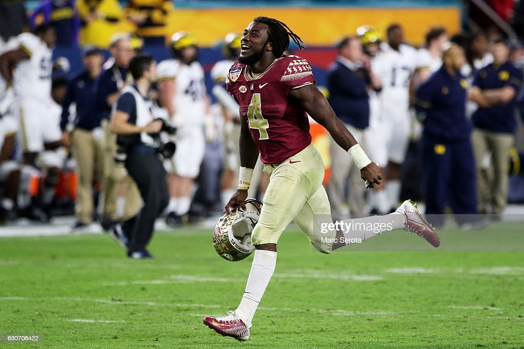 Dalvin Cook #4 of the Florida State Seminoles celebrates their 33 to 32 win over the Michigan Wolverines during the Capitol One Orange Bowl at Sun Life Stadium on December 30, 2016 in Miami Gardens, Florida.