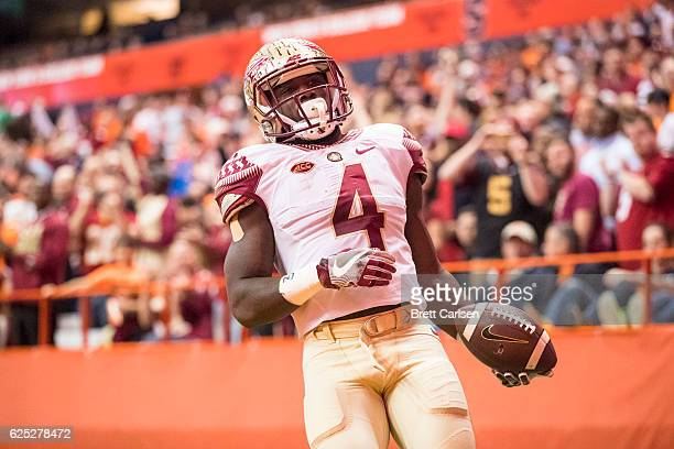 Dalvin Cook of the Florida State Seminoles holds the ball after a run during the first half against the Syracuse Orange on November 19 2016 at The...