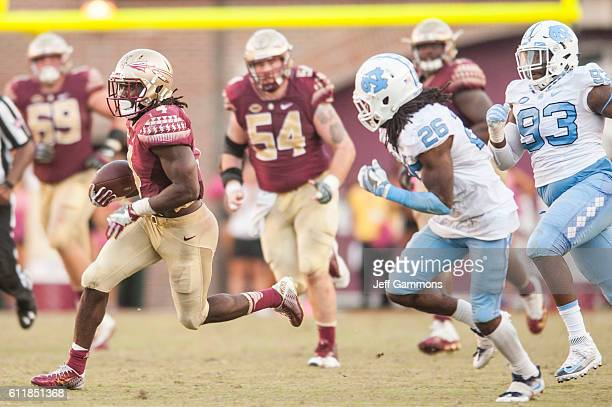 Dalvin Cook of the Florida State Seminoles looks for a route during the game against the North Carolina Tar Heels at Doak Campbell Stadium on October...