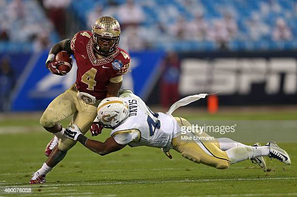 Dalvin Cook of the Florida State Seminoles runs the ball against Paul Davis of the Georgia Tech Yellow Jackets in the 2nd quarter during the ACC...
