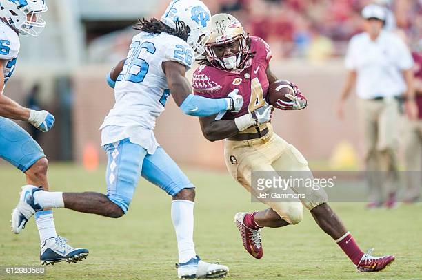 Dalvin Cook of the Florida State Seminoles runs the ball during the game against the North Carolina Tar Heels at Doak Campbell Stadium on October 1...