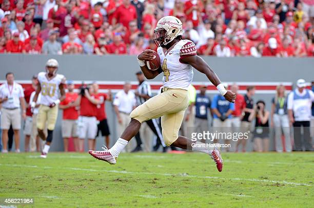 Dalvin Cook of the Florida State Seminoles runs untouch into the end zone for a touchdown during their game against the North Carolina State Wolfpack...