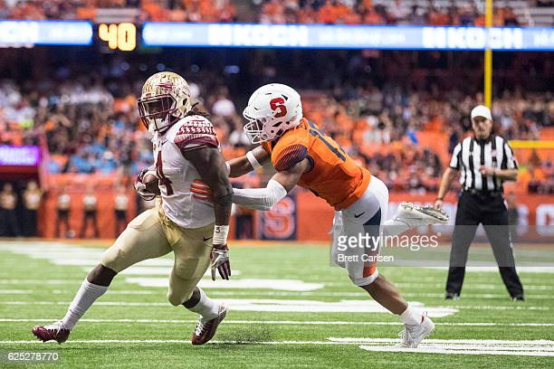 Dalvin Cook of the Florida State Seminoles runs with the ball for a touchdown against the Syracuse Orange on November 19 2016 at The Carrier Dome in...