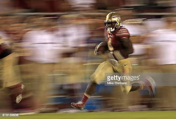 Dalvin Cook of the Florida State Seminoles rushes during a game against the Clemson Tigers at Doak Campbell Stadium on October 29 2016 in Tallahassee...