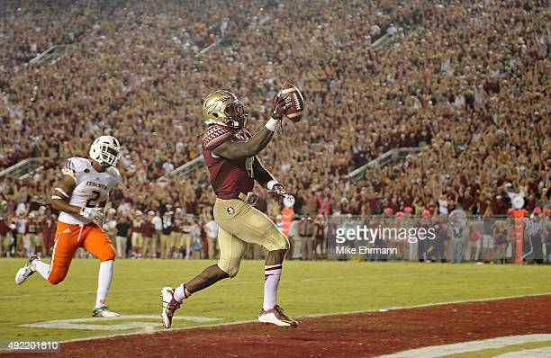 Dalvin Cook of the Florida State Seminoles rushes for a touchdown during a game against the Miami Hurricanes at Doak Campbell Stadium on October 10,...