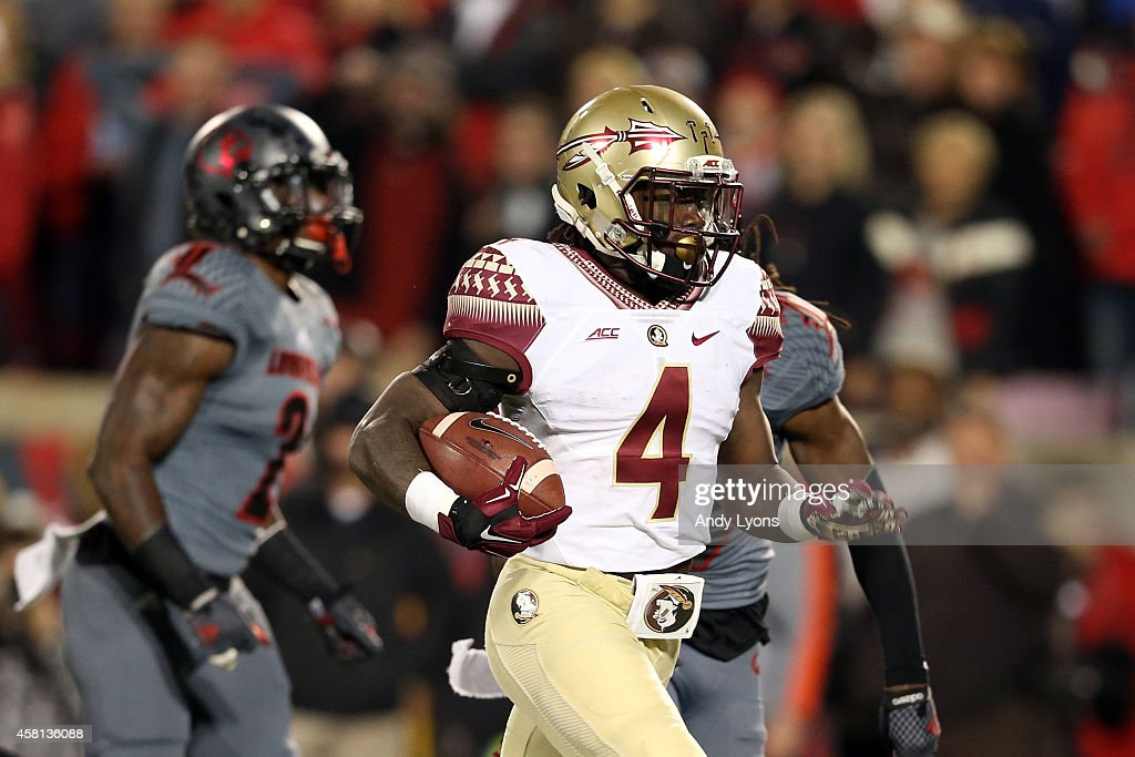 Dalvin Cook #4 of the Florida State Seminoles scores a 40 yard touchdown in the third quarter against the Louisville Cardinals during their game at Papa John's Cardinal Stadium on October 30, 2014 in Louisville, Kentucky.