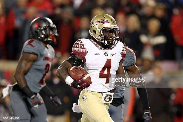 Dalvin Cook of the Florida State Seminoles scores a 40 yard touchdown in the third quarter against the Louisville Cardinals during their game at Papa...