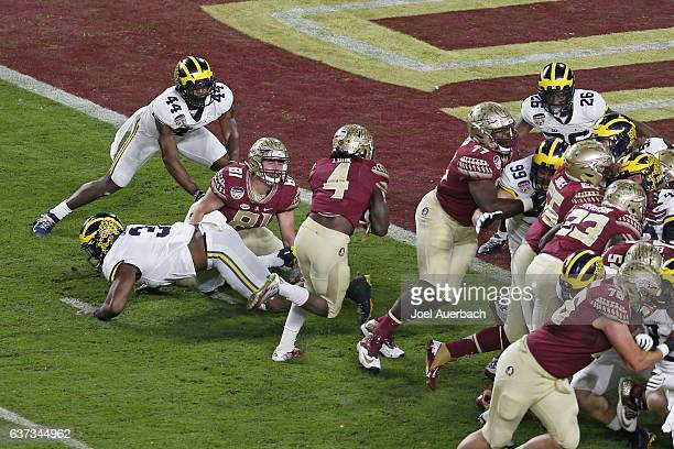 Dalvin Cook of the Florida State Seminoles scores a first quarter touchdown against the Michigan Wolverines during the 2016 Capital One Orange Bowl...