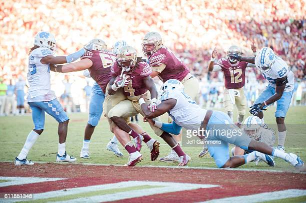 Dalvin Cook of the Florida State Seminoles scores a touchdown during the game against the North Carolina Tar Heels at Doak Campbell Stadium on...