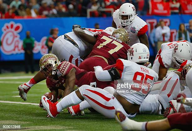 Dalvin Cook of the Florida State Seminoles scores a touchdown in the third quarter against the Houston Cougars during the ChickfilA Peach Bowl at the...