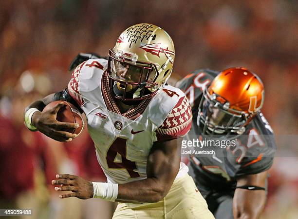 Dalvin Cook of the Florida State Seminoles scores the winning touchdown in the fourth quarter against the Miami Hurricanes on November 15 2014 at Sun...