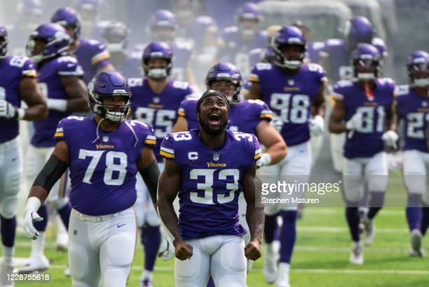 Dalvin Cook of the Minnesota Vikings and his teammates take the field before the game against the Tennessee Titans at U.S. Bank Stadium on September...