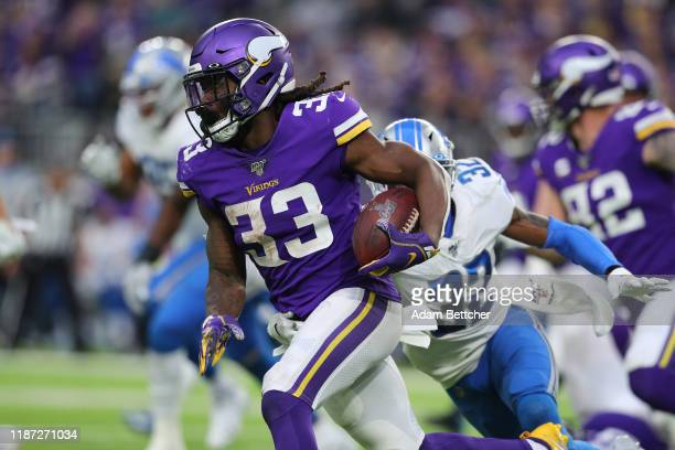 Dalvin Cook of the Minnesota Vikings carrels the ball for a gain in the fourth quarter against the Detroit Lions at U.S. Bank Stadium on December 8,...