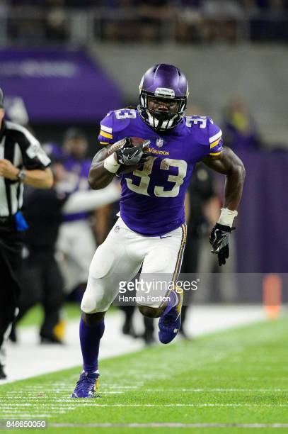 Dalvin Cook of the Minnesota Vikings carries the ball against the New Orleans Saints during the game on September 11 2017 at US Bank Stadium in...