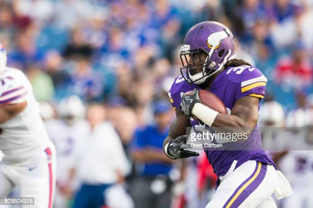 Dalvin Cook of the Minnesota Vikings carries the ball during the first quarter of a preseason game against the Buffalo Bills on August 10 2017 at New...