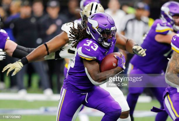 Dalvin Cook of the Minnesota Vikings carries the ball during the first half against the New Orleans Saints in the NFC Wild Card Playoff game at...