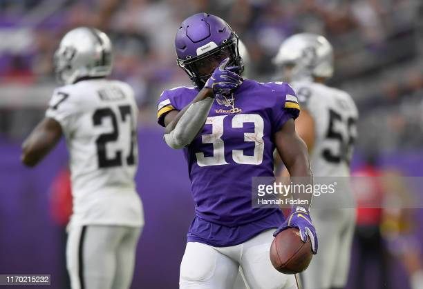 Dalvin Cook of the Minnesota Vikings celebrates a first down against the Oakland Raiders during the third quarter of the game at U.S. Bank Stadium on...