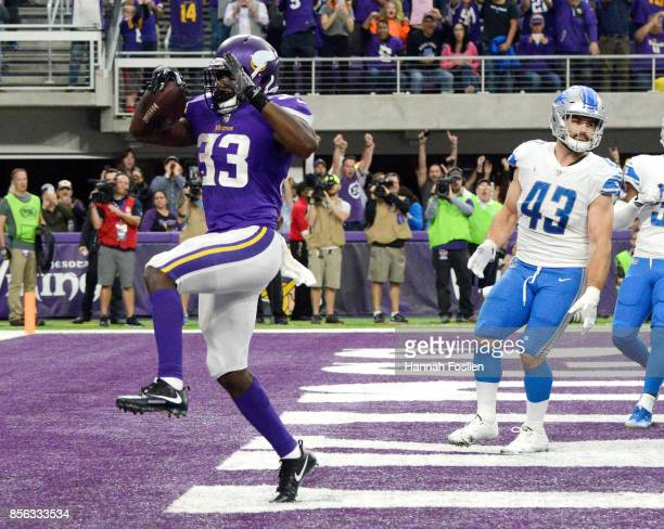 Dalvin Cook of the Minnesota Vikings celebrates a rushing touchdown in the second quarter of the game against the Detroit Lions on October 1 2017 at...