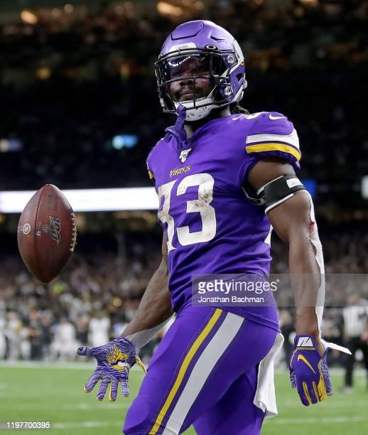 Dalvin Cook of the Minnesota Vikings celebrates a touchdown during the first half against the New Orleans Saints in the NFC Wild Card Playoff game at...