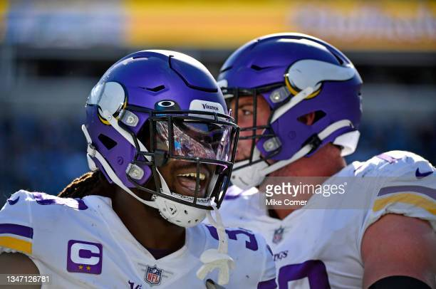 Dalvin Cook of the Minnesota Vikings celebrates a touchdown during the third quarter against the Carolina Panthers at Bank of America Stadium on...