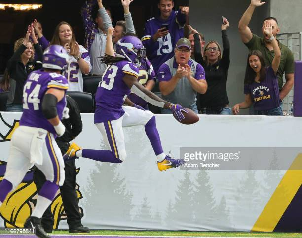 Dalvin Cook of the Minnesota Vikings celebrates a touchdown in the first quarter against the Atlanta Falcons at U.S. Bank Stadium on September 8,...