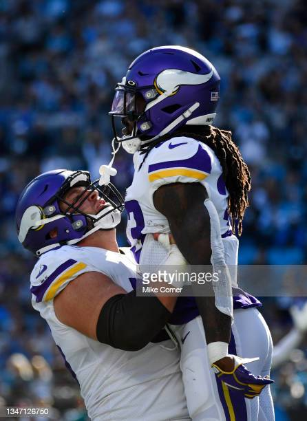 Dalvin Cook of the Minnesota Vikings celebrates a touchdown with teammate Garrett Bradbury during the third quarter against the Carolina Panthers at...