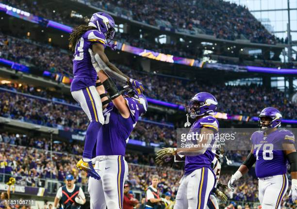 Dalvin Cook of the Minnesota Vikings celebrates after scoring a touchdown in the fourth quarter of the game against the Denver Broncos at US Bank...