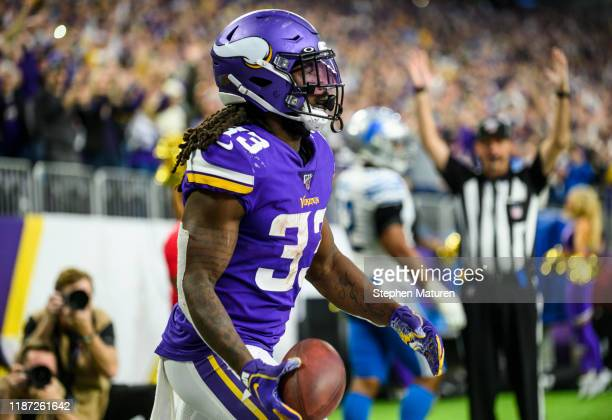 Dalvin Cook of the Minnesota Vikings celebrates after scoring a touchdown in the second quarter of the game against the Detroit Lions at US Bank...