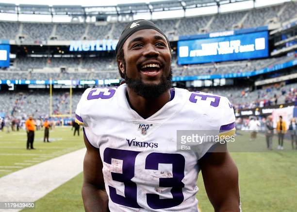 Dalvin Cook of the Minnesota Vikings celebrates as he leaves the field after the 28-10 win over the New York Giants at MetLife Stadium on October 06,...