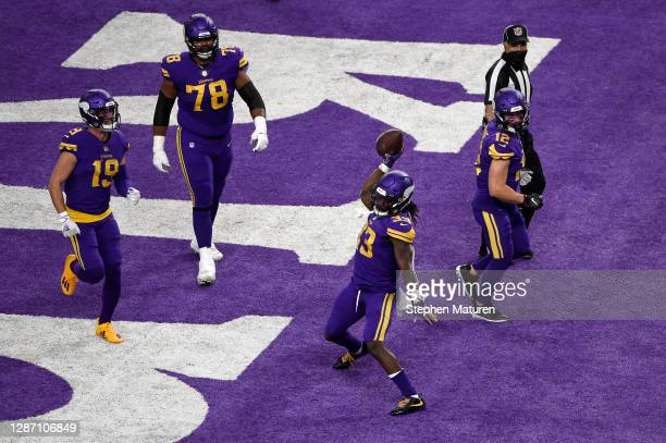 Dalvin Cook of the Minnesota Vikings celebrates following a touchdown run in the during their game against the Dallas Cowboys at U.S. Bank Stadium on...