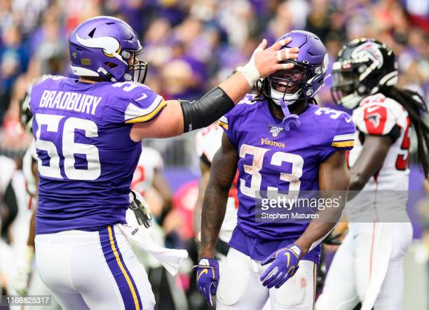 Dalvin Cook of the Minnesota Vikings celebrates with teammate Garrett Bradbury after scoring a touchdown in the third quarter of the game against the...