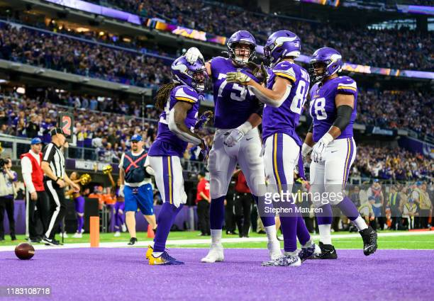 Dalvin Cook of the Minnesota Vikings celebrates with teammates after scoring a touchdown in the fourth quarter of the game against the Denver Broncos...