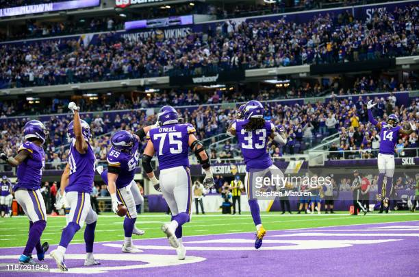 Dalvin Cook of the Minnesota Vikings celebrates with teammates after scoring a touchdown in the second quarter of the game against the Detroit Lions...