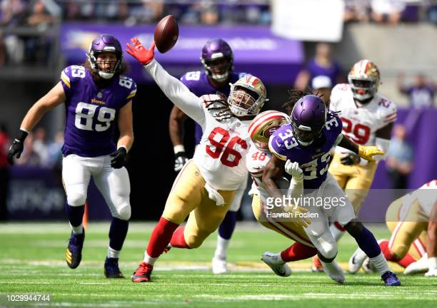 Dalvin Cook of the Minnesota Vikings fumbles the ball in the second quarter of the game against the San Francisco 49ers at US Bank Stadium on...