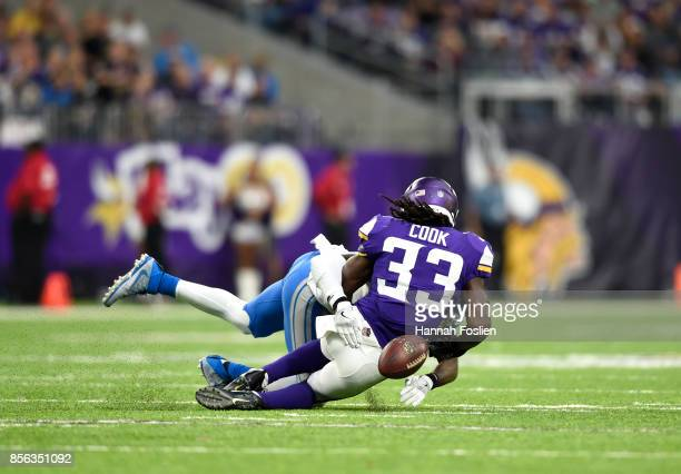 Dalvin Cook of the Minnesota Vikings fumbles the ball while being tackled by defender Tavon Wilson of the Detroit Lions in the third quarter of the...