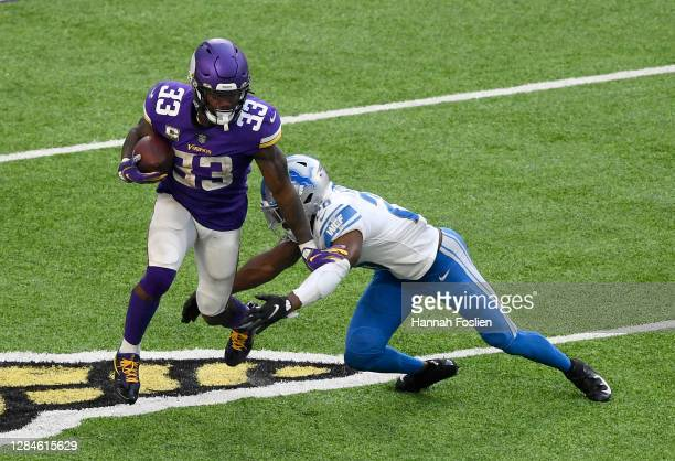 Dalvin Cook of the Minnesota Vikings is tackled by Duron Harmon of the Detroit Lions at U.S. Bank Stadium on November 08, 2020 in Minneapolis,...