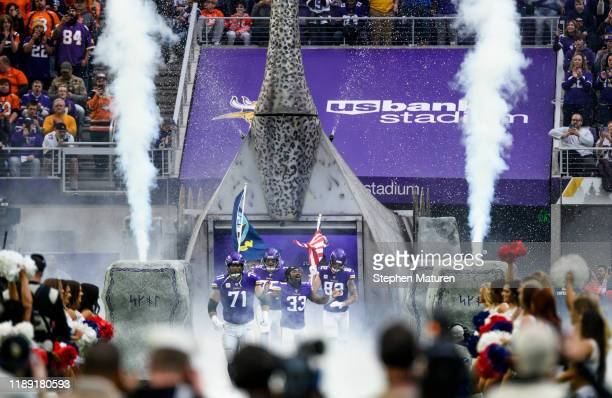 Dalvin Cook of the Minnesota Vikings leads the team out of the tunnel during player introductions before the game against the Denver Broncos at US...